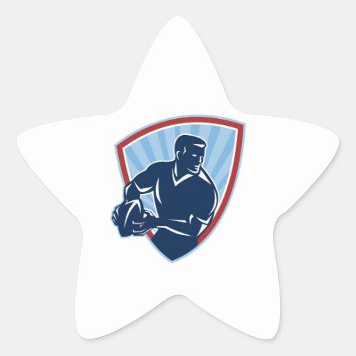 Jugador del rugbi que pasa el escudo de la bola pegatinas forma de estrellaes