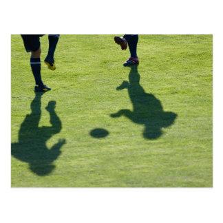 Jugadores de fútbol que hacen los taladros postal