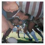 Jugadores de la unión del rugbi en un melé tejas