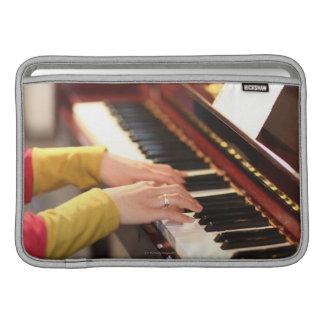 Jugar el piano funda  MacBook
