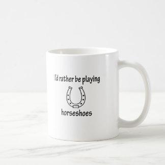 Jugar las herraduras tazas de café