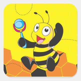 Juguete sonriente feliz amarillo lindo del pegatina cuadrada
