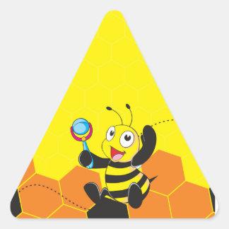 Juguete sonriente feliz amarillo lindo del pegatina triangular