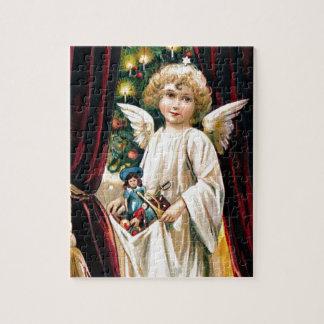 Juguetes y árbol de navidad del ángel del niño del rompecabeza con fotos