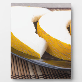 Juicy yellow melon on wooden background plaque