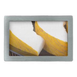 Juicy yellow melon on wooden background rectangular belt buckle