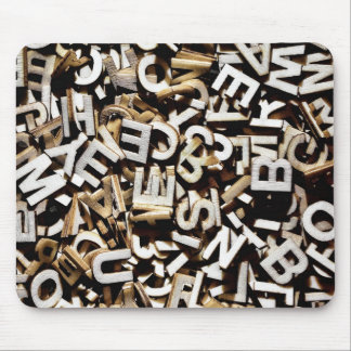 Jumbled letters made of wood close up mouse pad