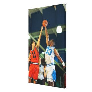 Jump ball in basketball game canvas print