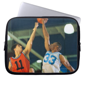 Jump ball in basketball game laptop sleeve