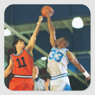 Jump ball in basketball game square sticker