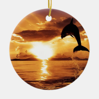 jumping dolphin with beautiful sunset over the sea ceramic ornament
