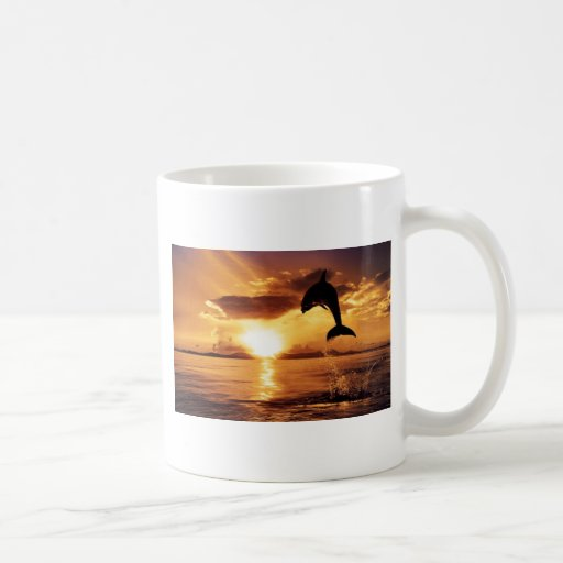 jumping dolphin with beautiful sunset over the sea classic white coffee mug