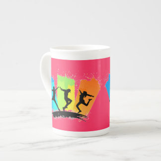 Jumping people silhouettes colorful - tea cup