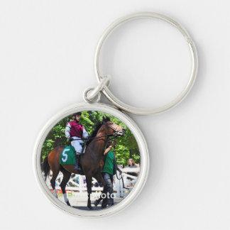 Junior Alvarado on Aslan Silver-Colored Round Keychain
