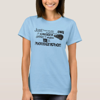 Just because you own a camera doesn't make you... T-Shirt