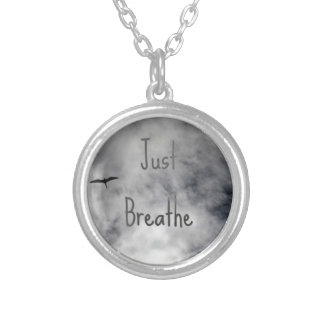 Just Breathe Bird Flying in Cloudy Sky Round Pendant Necklace