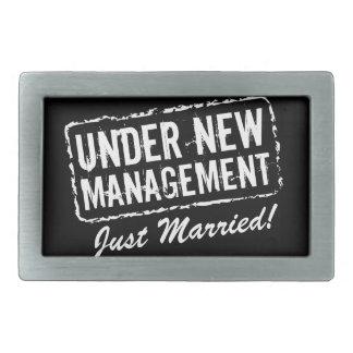 Just Married belt buckles | Under new management