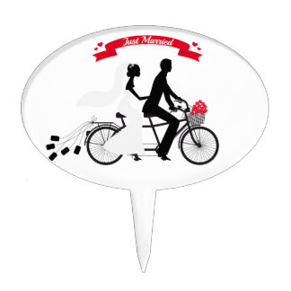 Just married bride and groom on tandem bicycle cake topper
