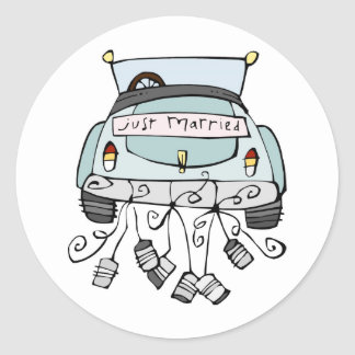 Just married car dragging cans round stickers