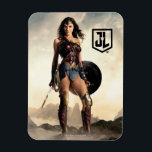 "Justice League | Wonder Woman On Battlefield Magnet<br><div class=""desc"">Check out Justice League&#39;s Wonder Woman standing with sword and shield in either hand on a mist filled,  rocky terrain. The sun rises behind her,  causing the mist and clouds to glow bright.</div>"