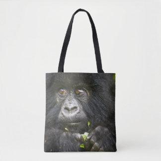 Juvenile Mountain Gorilla feeds on tender leaves 2 Tote Bag
