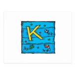 K está para la cometa postal