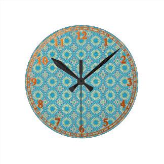 Kaleidoscope with shades of blue round clock
