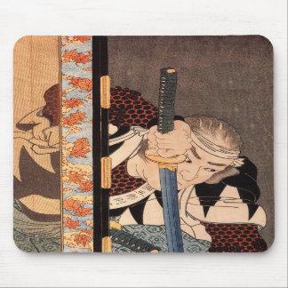 Kansaki Yagoro Noriyasu seen behind a transparent Mouse Pads