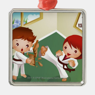 Karate boy holding wood with another breaking it metal ornament