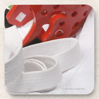 Karate gi and sparring headgear drink coasters