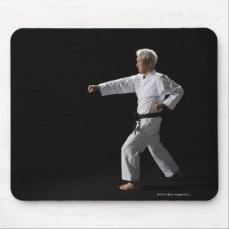 Karate master demonstrating, studio shot mouse pad