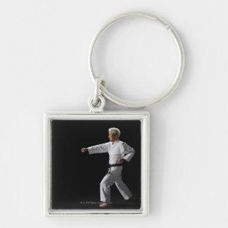 Karate master demonstrating, studio shot Silver-Colored square keychain