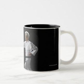 Karate master demonstrating, studio shot Two-Tone coffee mug