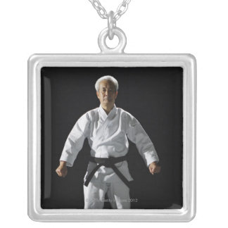 Karate master, portrait, studio shot silver plated necklace