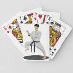 "Karate Pose Playing Cards<br><div class=""desc"">Strike an awesome karate pose just like this one. This person is in there karate outfit and they are in a karate pose. This karate person is wearing a black belt. This karate pose design looks great on these playing cards. Perfect for yourself or as a gift</div>"
