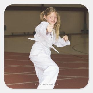 Karate practicante del chica pegatina cuadradas