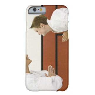 Karate teacher and boy (4-5 years) bowing to barely there iPhone 6 case