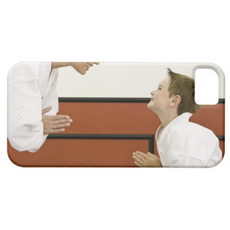 Karate teacher and boy (4-5 years) bowing to iPhone SE/5/5s case