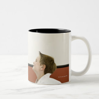 Karate teacher and boy (4-5 years) bowing to Two-Tone coffee mug
