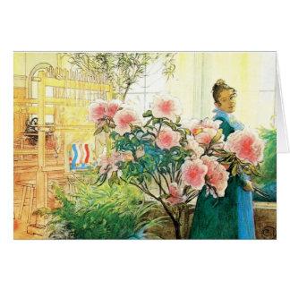 Karin con las flores rosadas y su telar tarjetón