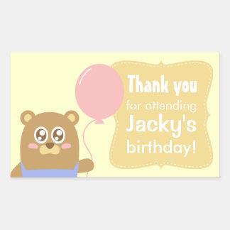 Kawaii brown bear holding a pink balloon rectangular sticker
