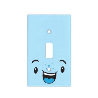 Kawaii sonriente azul hace frente a la cubierta de cubierta para interruptor