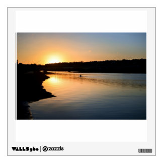 Kayaker paddles on the river at sunset wall sticker