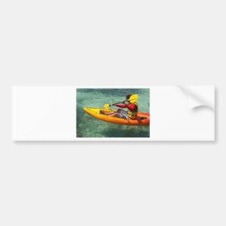 Kayaker paddling in clear water bumper sticker