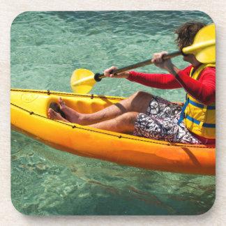 Kayaker paddling in clear water drink coasters