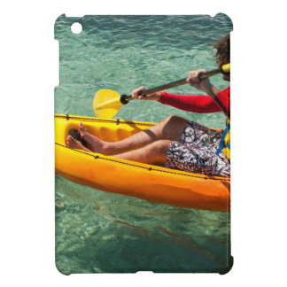 Kayaker paddling in clear water iPad mini covers