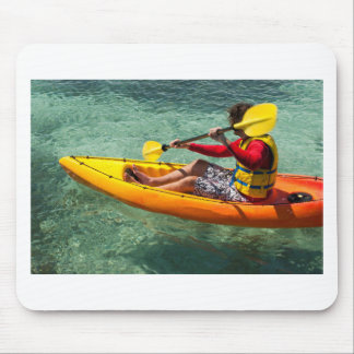 Kayaker paddling in clear water mouse pad