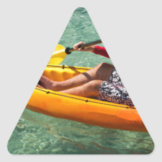 Kayaker paddling in clear water sticker
