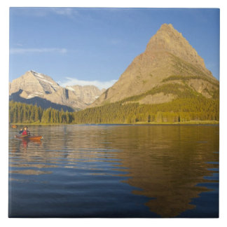 Kayaking in Swiftcurrent Lake at sunrise in the Ceramic Tile