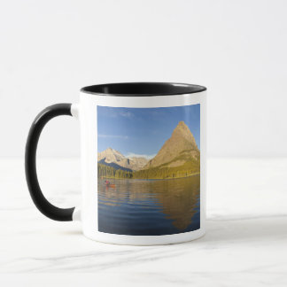 Kayaking in Swiftcurrent Lake at sunrise in the Mug